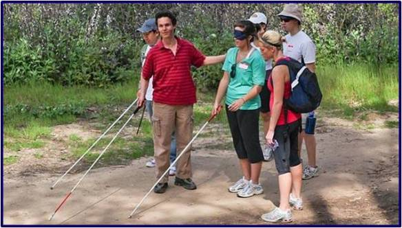 Daniel Kish teaches a group how to navigate nature trails.